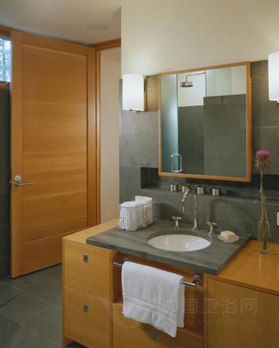 洗手间装修效果图很清新小巧,灰色的墙壁和马赛克装饰带给洗